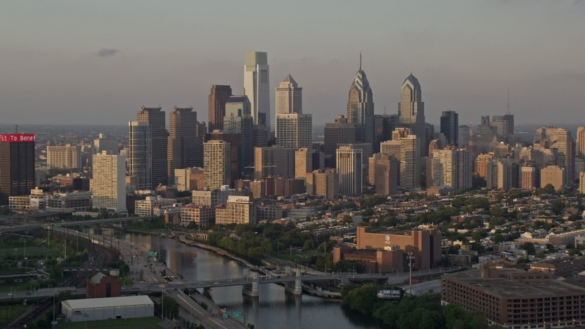 5K stock footage aerial video of Downtown Philadelphia skyline seen from Schuylkill River, Pennsylvania, Sunset Aerial Stock Footage | AX80_090E