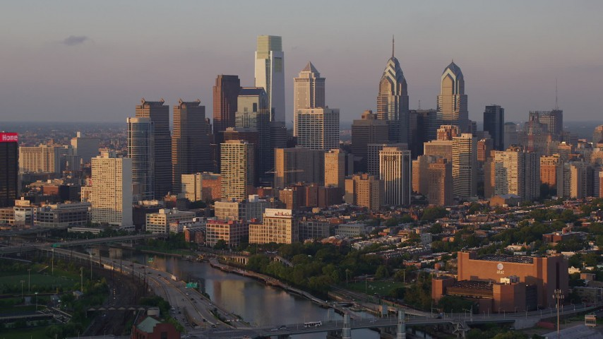 5K stock footage aerial video approaching Downtown Philadelphia skyscrapers from Schuylkill River, Pennsylvania, Sunset Aerial Stock Footage | AX80_091