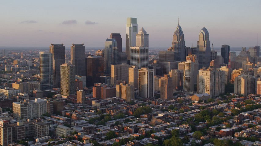 5K stock footage aerial video approaching and flying by Downtown Philadelphia skyscrapers in Pennsylvania at Sunset Aerial Stock Footage | AX80_093