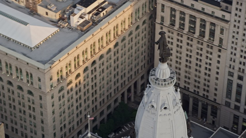 5K aerial video of the William Penn statue on top of Philadelphia City Hall, Pennsylvania, Sunset Aerial Stock Footage | AX80_096