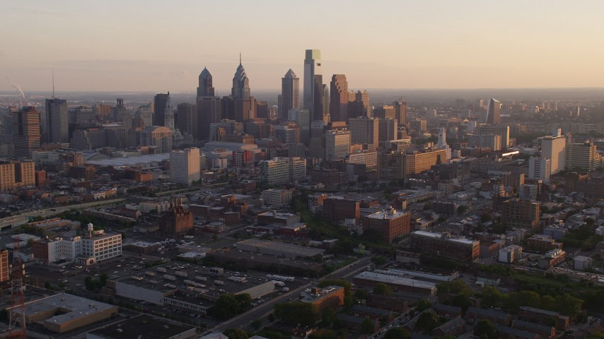 5K stock footage aerial video of Downtown Philadelphia skyline and the I-676 freeway, Pennsylvania, at sunset Aerial Stock Footage | AX80_097