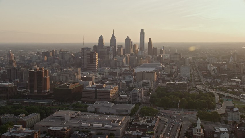 5K aerial video of Downtown Philadelphia skyscrapers at sunset in Pennsylvania Aerial Stock Footage | AX80_099