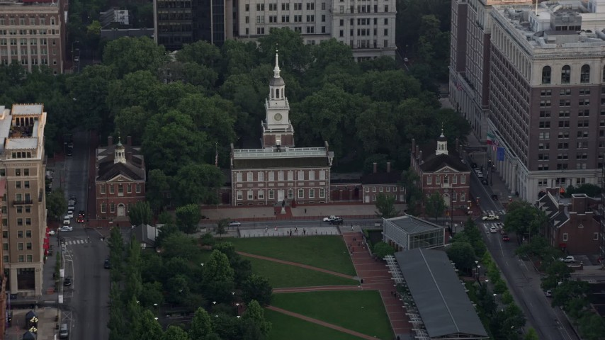5K aerial video approaching Old City Hall and Independence Hall, Downtown Philadelphia, Pennsylvania, Sunset Aerial Stock Footage | AX80_100