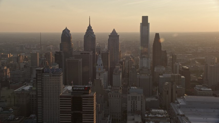 5K stock footage aerial video approaching City Hall and Downtown Philadelphia skyscrapers, Pennsylvania, Sunset Aerial Stock Footage | AX80_101