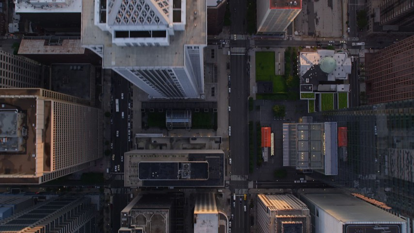 5K aerial video of a bird's eye view of JFK Boulevard, JFK Plaza, city buildings in Downtown Philadelphia, Pennsylvania, Sunset Aerial Stock Footage AX80_103