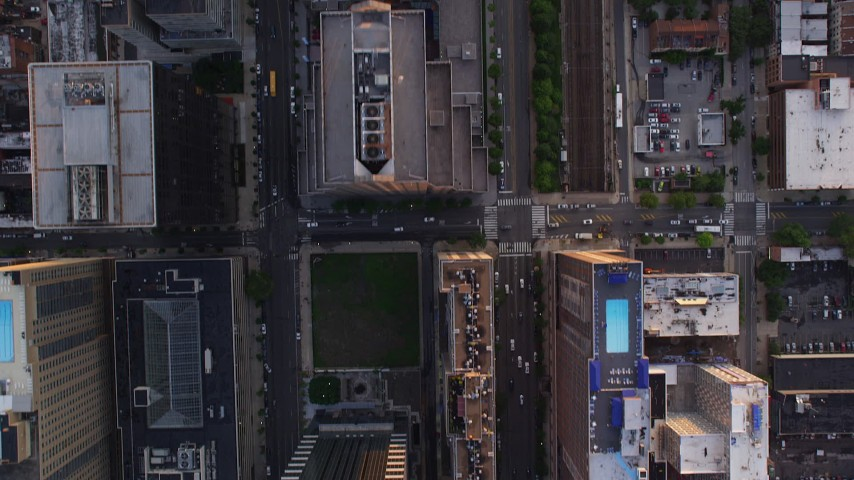 5K stock footage aerial video of a bird's eye view of John F Kennedy Boulevard, reveal One and Two Commerce Square, Downtown Philadelphia, Pennsylvania, Sunset Aerial Stock Footage | AX80_104