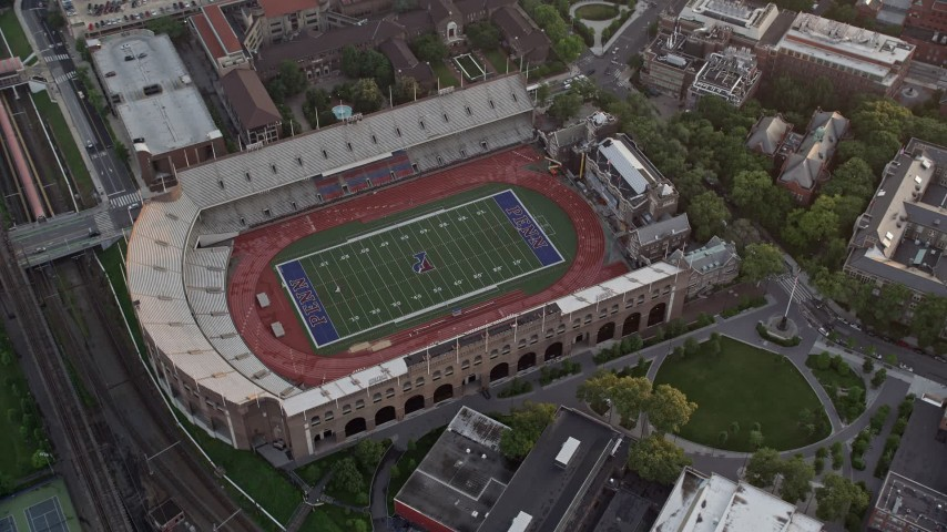 5K stock footage aerial video of a bird's eye view of Franklin Field at University of Pennsylvania, West Philadelphia, Sunset Aerial Stock Footage AX80_106 | Axiom Images