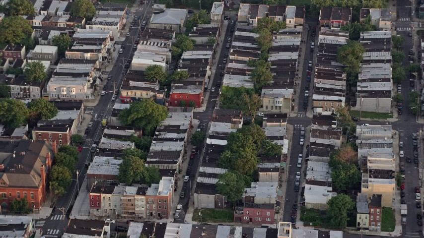 5K stock footage aerial video of row houses and city streets in South Philadelphia, Pennsylvania, Sunset Aerial Stock Footage | AX80_107