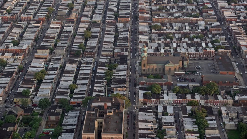 5K stock footage aerial video of an urban neighborhood around St. Thomas Aquinas Church, South Philadelphia, Pennsylvania Sunset Aerial Stock Footage | AX80_108