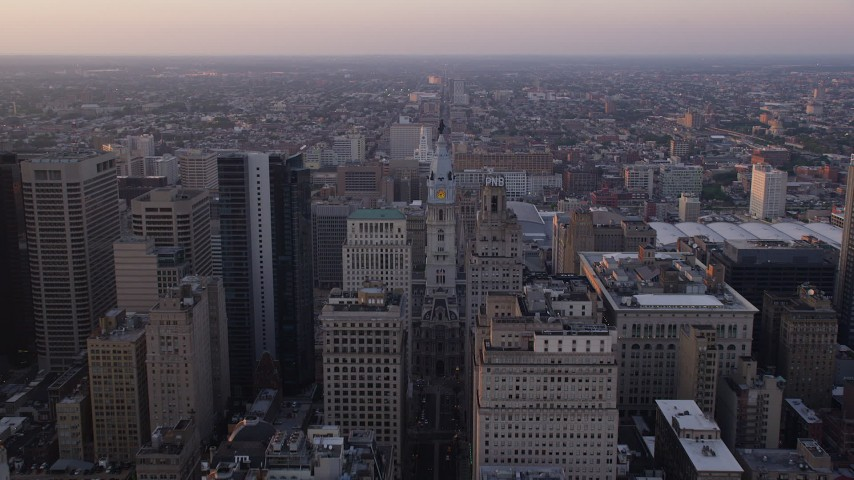 5K stock footage aerial video approaching Philadelphia City Hall's William Penn statue, Downtown Philadelphia, Pennsylvania, Sunset Aerial Stock Footage | AX80_115