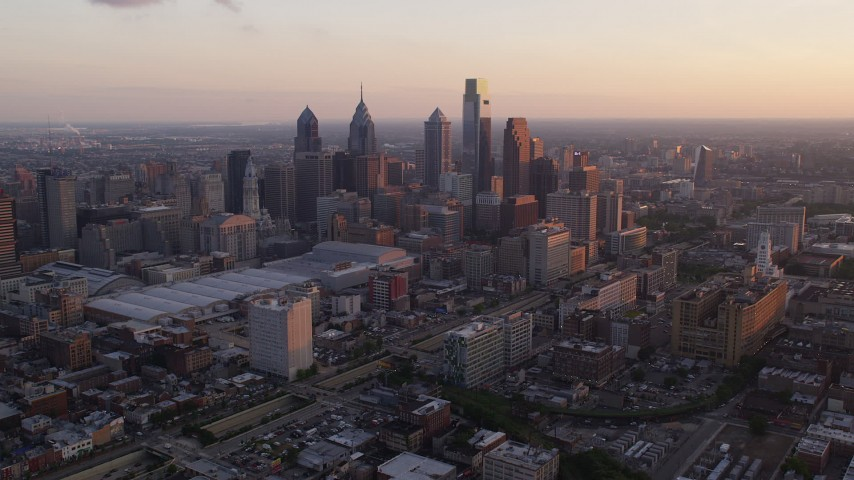 5K stock footage aerial video of Downtown Philadelphia skyscrapers and Pennsylvania Convention Center, Sunset Aerial Stock Footage | AX80_117