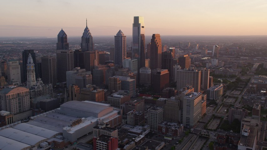 5K aerial video approaching Downtown Philadelphia's giant skyscrapers, Pennsylvania, Sunset Aerial Stock Footage | AX80_118