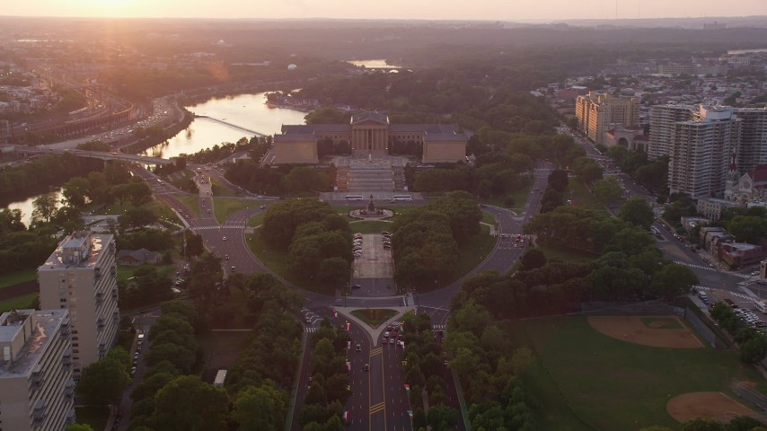 5K stock footage aerial video tilting from Logan Square to reveal Philadelphia Museum of Art, Pennsylvania, Sunset Aerial Stock Footage | AX80_120