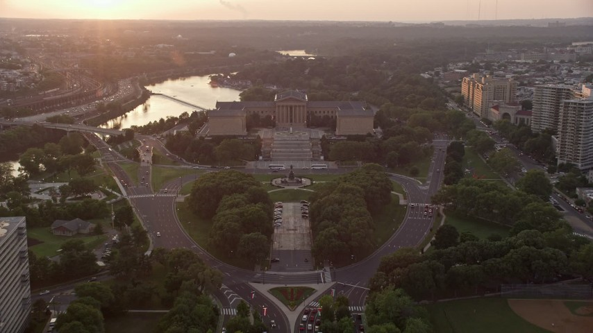 5K stock footage aerial video tilting from Logan Square to reveal Philadelphia Museum of Art, Pennsylvania, Sunset Aerial Stock Footage   AX80_120E