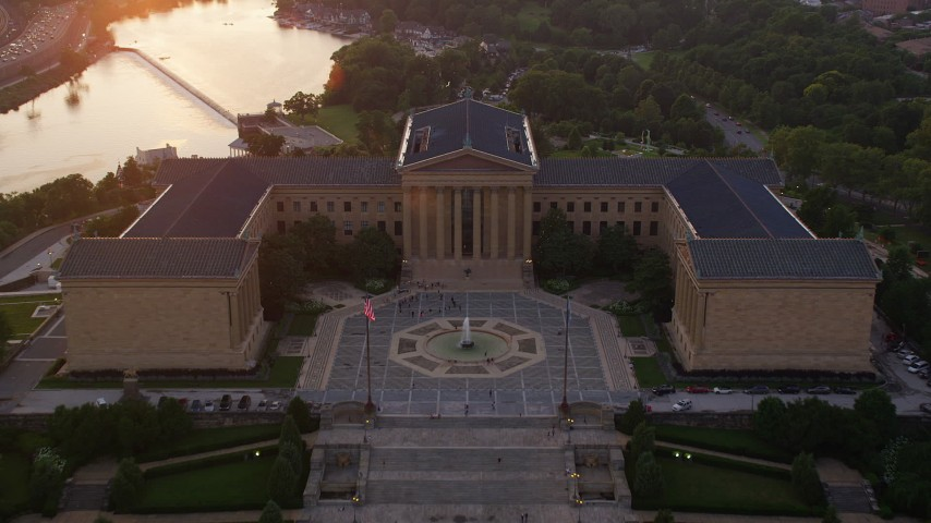 5K aerial video flying over The Oval park and Philadelphia Museum of Art, Pennsylvania, Sunset Aerial Stock Footage | AX80_121
