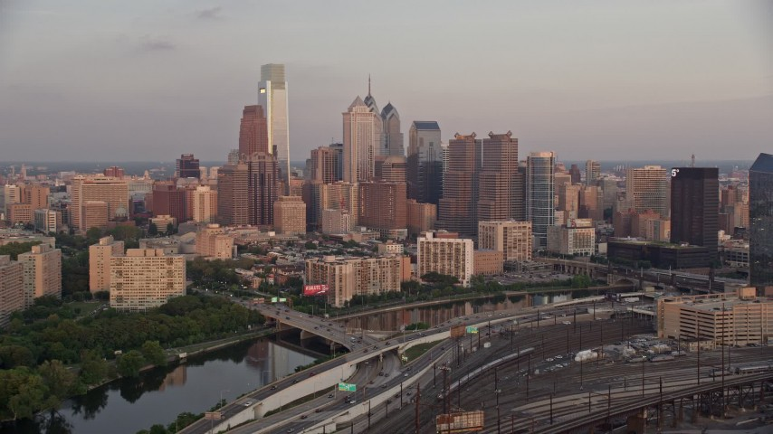 5K stock footage aerial video of Downtown Philadelphia skyline seen from Schuylkill River, Pennsylvania, Sunset Aerial Stock Footage | AX80_123
