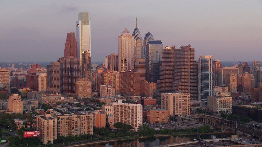 5K aerial video flying by Downtown Philadelphia skyline, reveal Cira Centre, Pennsylvania, Sunset Aerial Stock Footage AX80_124