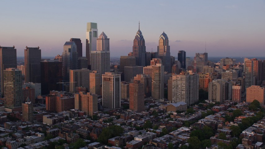 5K stock footage aerial video flying by Downtown Philadelphia skyscrapers, Pennsylvania, Sunset Aerial Stock Footage | AX80_127