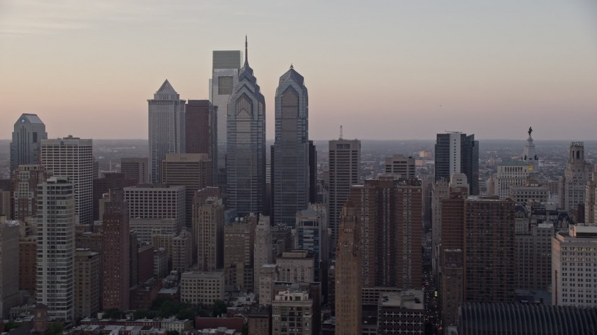 5K stock footage aerial video flying by Downtown Philadelphia skyscrapers and City Hall, Pennsylvania, Sunset Aerial Stock Footage | AX80_129