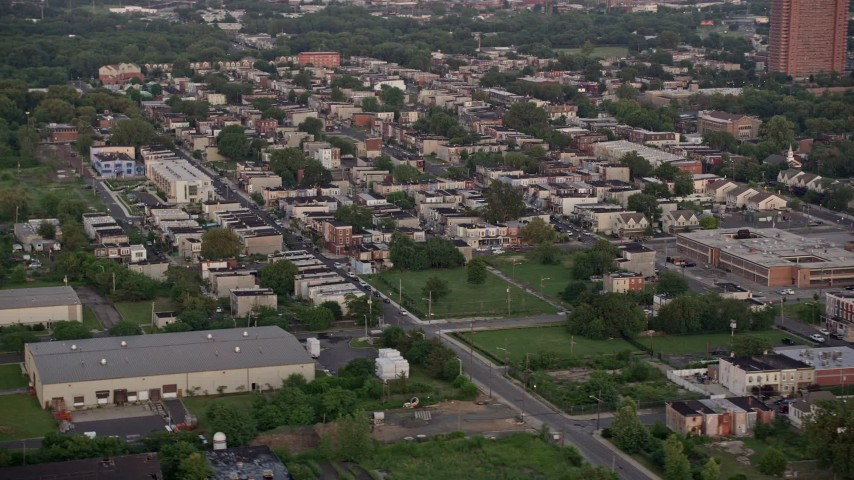 5K stock footage aerial video of row houses around Erie and York Streets in Camden, New Jersey, Sunset Aerial Stock Footage | AX80_134