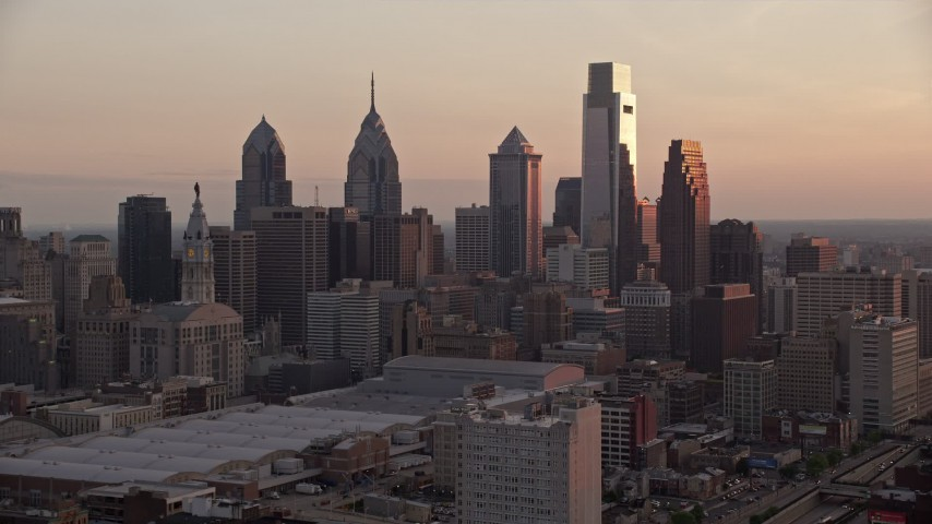 5K stock footage aerial video approaching tall skyscrapers in Downtown Philadelphia, Pennsylvania, Sunset Aerial Stock Footage | AX80_142