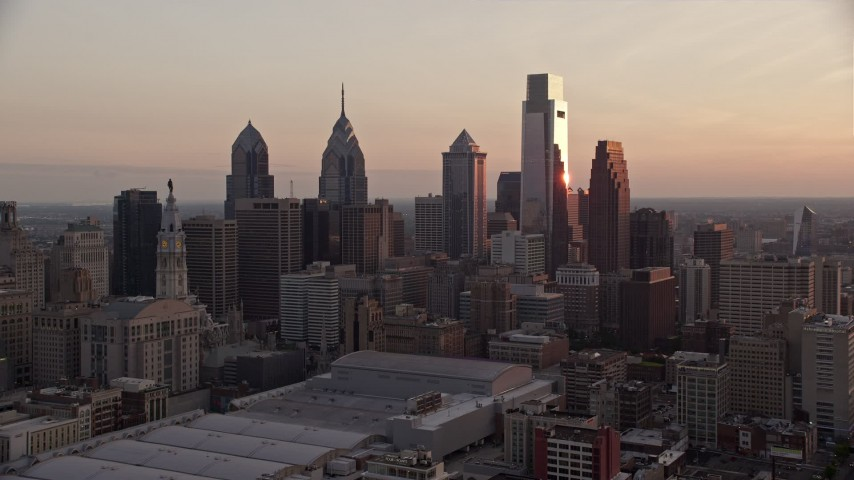 5K stock footage aerial video flying by tall skyscrapers in Downtown Philadelphia skyline, Pennsylvania, Sunset Aerial Stock Footage | AX80_143