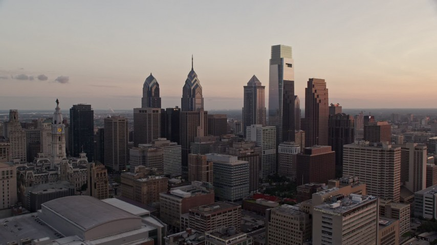 5K stock footage aerial video of Downtown Philadelphia's tallest towers at twilight, Pennsylvania Aerial Stock Footage | AX80_144