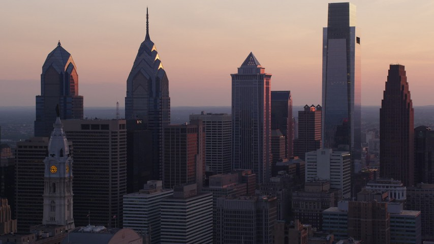 5K stock footage aerial video of tall Downtown Philadelphia skyscrapers and City Hall, Pennsylvania, Sunset Aerial Stock Footage | AX80_146