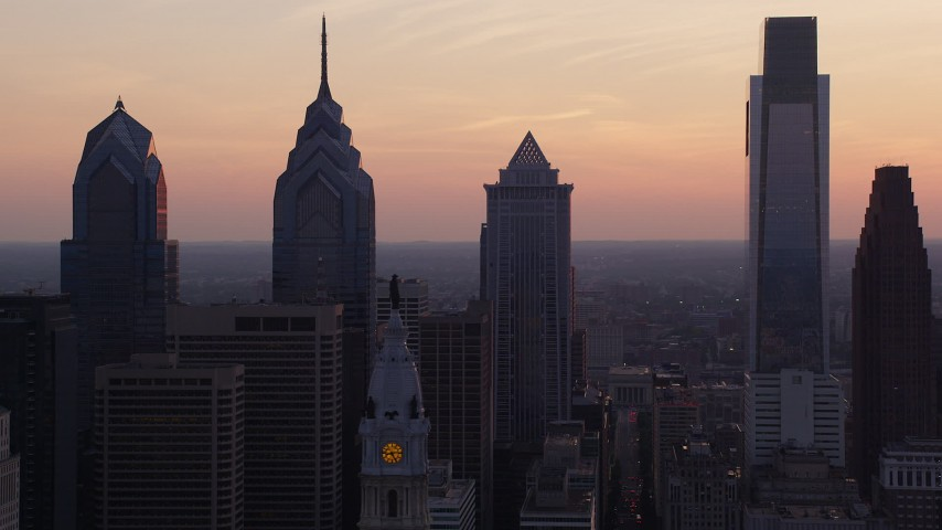 5K aerial video of Downtown Philadelphia skyscrapers and William Penn statue on City Hall, Pennsylvania, Sunset Aerial Stock Footage | AX80_147