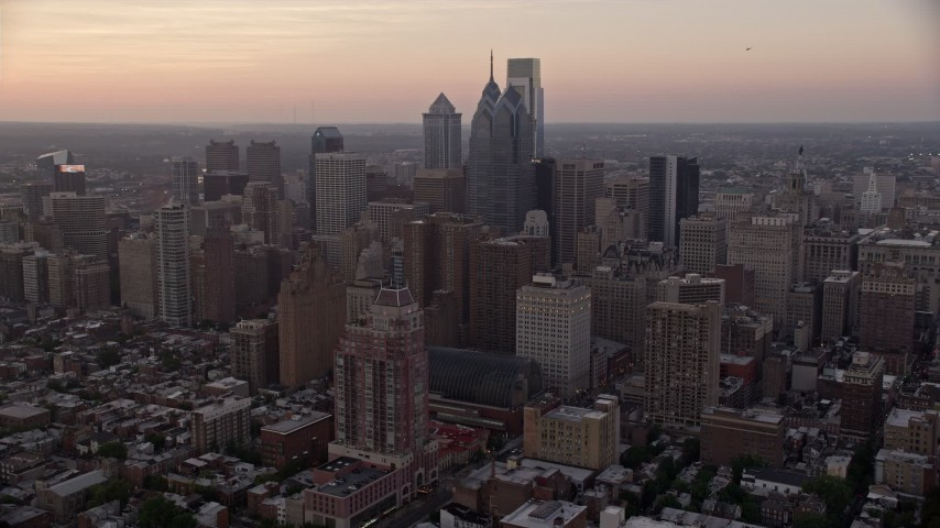 5K stock footage aerial video of a reverse view of Downtown Philadelphia skyscrapers, Pennsylvania, Sunset Aerial Stock Footage | AX80_149