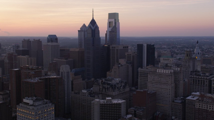 5K stock footage aerial video of Downtown Philadelphia skyscrapers, the setting sun in the background, Pennsylvania, Sunset Aerial Stock Footage | AX80_151