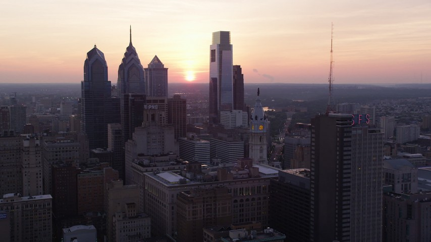 5K stock footage aerial video of Downtown Philadelphia skyscrapers and the setting sun in the background, Pennsylvania, Sunset Aerial Stock Footage | AX80_152