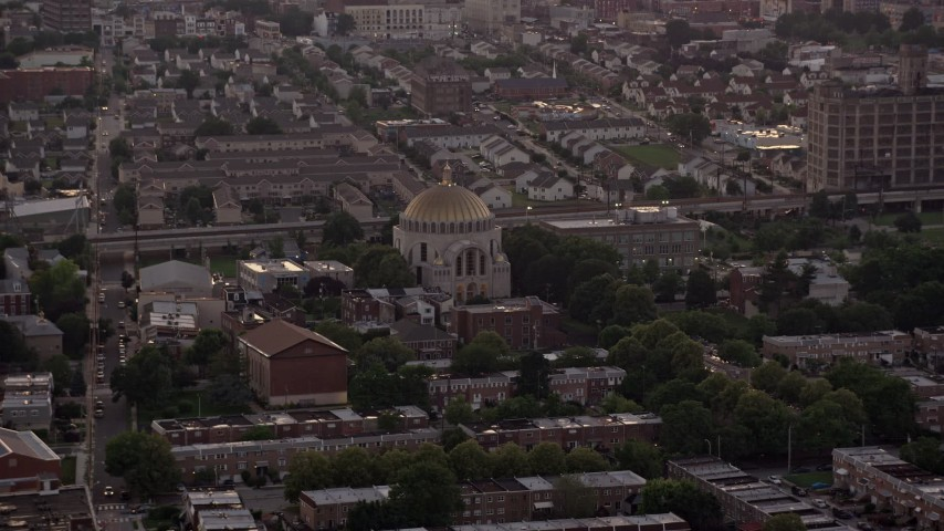 5K stock footage aerial video of Ukranian Cathedral Church in an urban neighborhood, North Philadelphia, Pennsylvania Sunset Aerial Stock Footage | AX80_154