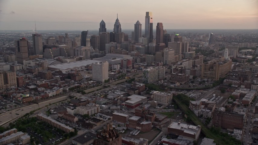 5K aerial video of Downtown Philadelphia skyline, Pennsylvania Convention Center, and I-676, Pennsylvania, Sunset Aerial Stock Footage | AX80_155