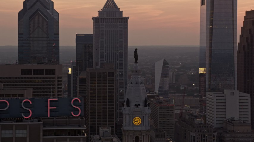 5K stock footage aerial video of the William Penn statue on Philadelphia City Hall, Pennsylvania, and setting sun in the background Aerial Stock Footage | AX80_156