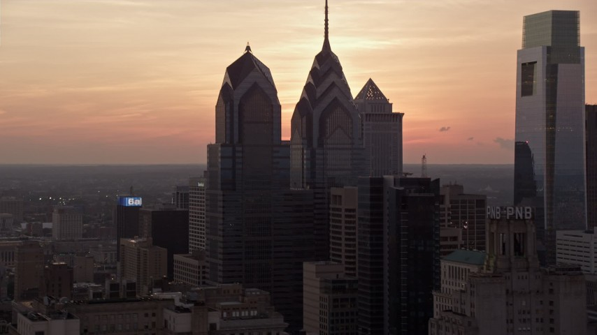5K stock footage aerial video of One and Two Liberty Place in Downtown Philadelphia, Pennsylvania, Sunset Aerial Stock Footage | AX80_157
