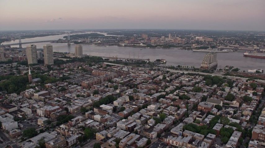 5K stock footage aerial video flying over South Philly to approach Delaware River and Camden, New Jersey, Sunset Aerial Stock Footage | AX80_159