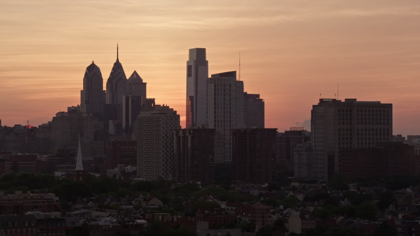 5K stock footage aerial video of the Downtown Philadelphia skyline, eclipsed by condo complex, Pennsylvania, Sunset Aerial Stock Footage | AX80_161