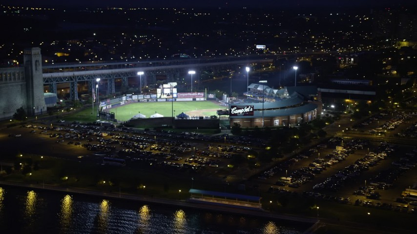 5K stock footage aerial video of a baseball game at Campbell's Field, Camden, New Jersey Night Aerial Stock Footage | AX81_003