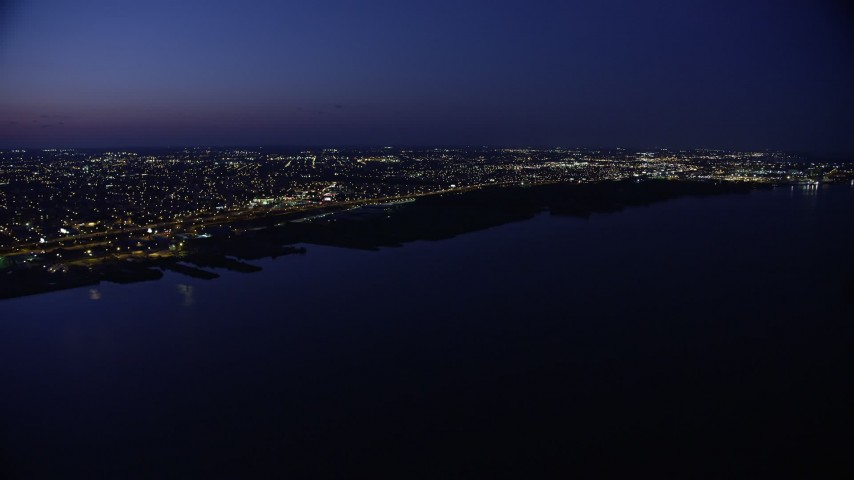 5K stock footage aerial video of Delaware River and city lights in North Philadelphia, Pennsylvania, Night Aerial Stock Footage | AX81_005