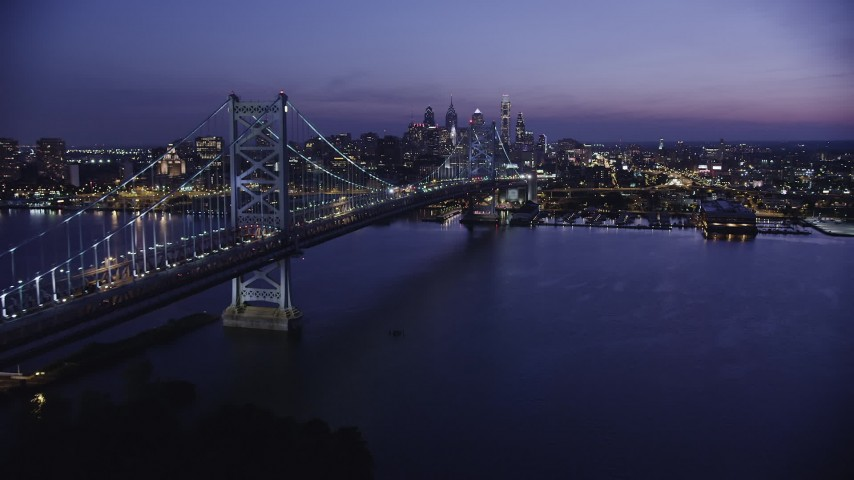 5K stock footage aerial video approaching Benjamin Franklin Bridge, Delaware River, and Downtown Philadelphia skyline, Pennsylvania, Night Aerial Stock Footage | AX81_008