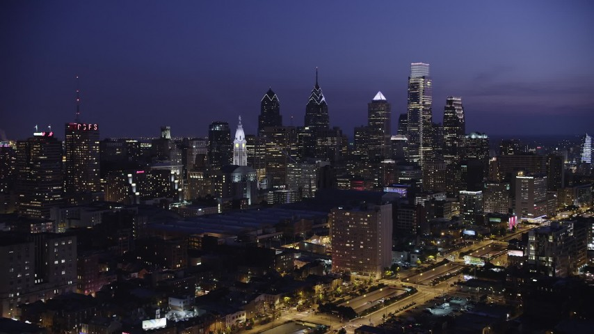 5K aerial video of Downtown Philadelphia skyscrapers and Pennsylvania Convention Center, Pennsylvania, Night Aerial Stock Footage | AX81_013