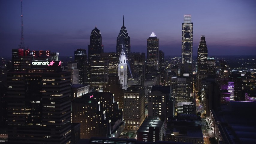 5K stock footage aerial video of Downtown Philadelphia skyscrapers and the City Hall clock tower, Pennsylvania, Night Aerial Stock Footage | AX81_015