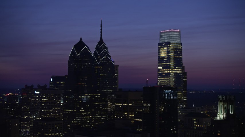 5K aerial video of One and Two Liberty Place, Comcast Center, Downtown Philadelphia, Pennsylvania, Night Aerial Stock Footage | AX81_016