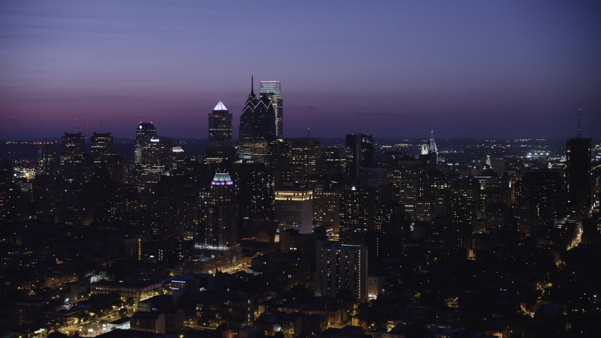 5K stock footage aerial video flying by high-rises and skyscrapers in Downtown Philadelphia, Pennsylvania, Night Aerial Stock Footage | AX81_017