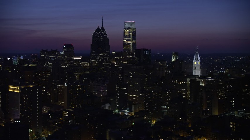5K stock footage aerial video flying by skyscrapers near city hall in Downtown Philadelphia, Pennsylvania, Night Aerial Stock Footage   AX81_017E