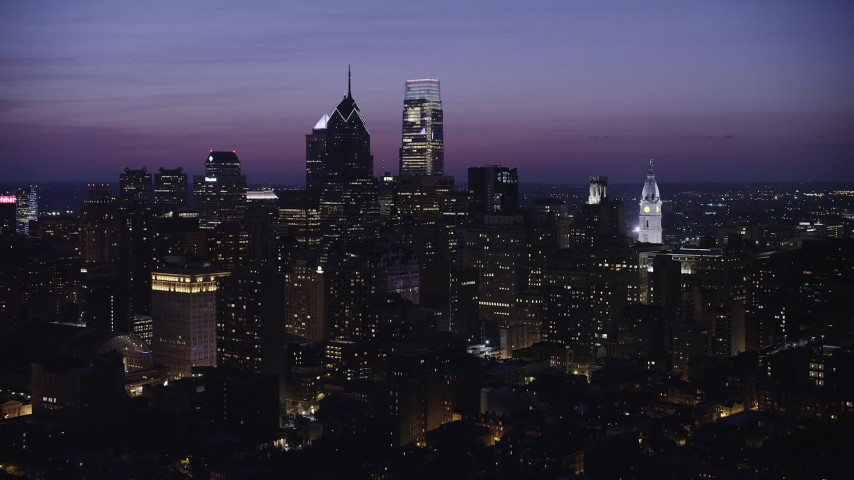 5K stock footage aerial video of Downtown Philadelphia skyscrapers and the City Hall clock tower in Pennsylvania at Night Aerial Stock Footage | AX81_018