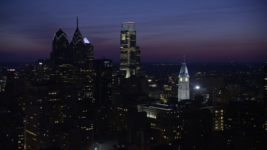 5K aerial video of Downtown Philadelphia's tall skyscrapers and the City Hall clock tower, Pennsylvania, Night Aerial Stock Footage | AX81_019