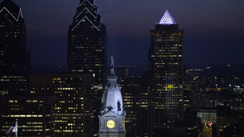 5K stock footage aerial video of the William Penn statue on top of Philadelphia City Hall, Pennsylvania, Night Aerial Stock Footage | AX81_020
