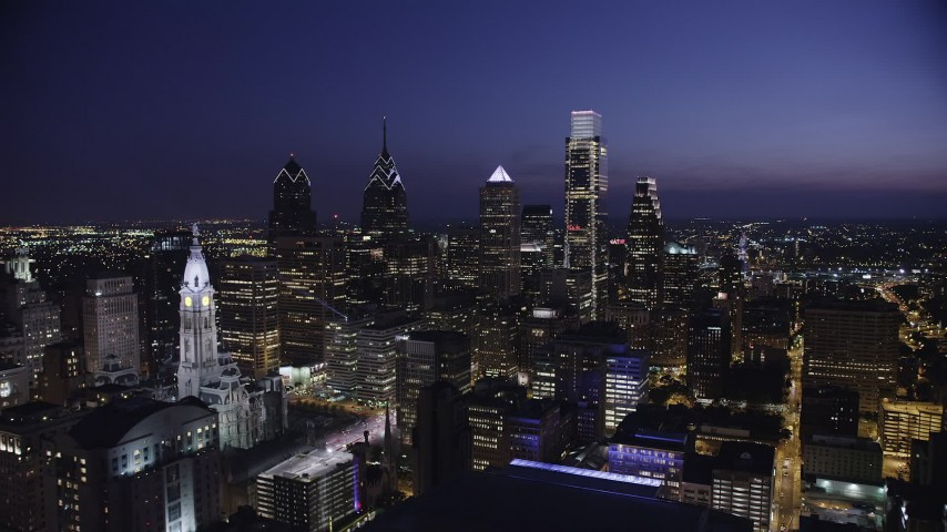 5K aerial video flying by City Hall and Downtown Philadelphia's tallest skyscrapers, Pennsylvania, Night Aerial Stock Footage | AX81_021